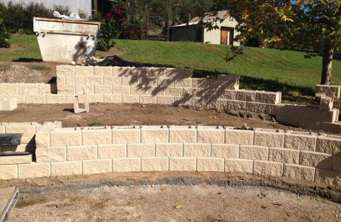 Retaining & Retention Walls-Lewisville TX Professional Landscapers & Outdoor Living Designs-We offer Landscape Design, Outdoor Patios & Pergolas, Outdoor Living Spaces, Stonescapes, Residential & Commercial Landscaping, Irrigation Installation & Repairs, Drainage Systems, Landscape Lighting, Outdoor Living Spaces, Tree Service, Lawn Service, and more.